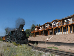 Durango and Silverton Narrow Guage Railroad passing by custom built townhomes by Buena Vista Builders in Durango Colorado